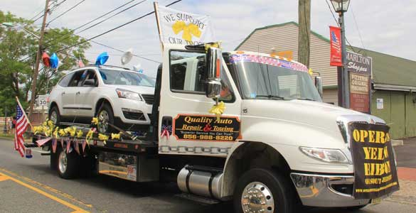 Flat Bed Tow truck Quality Auto Repair 4th of July